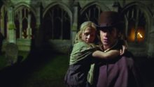 """Young Cosette (Isabelle Allen) holds on tight to Jean Valjean (Hugh Jackman) in """"Les Misérables"""" Universal Pictures"""